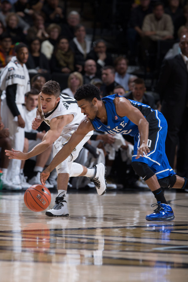 """Wake Forest's Mitchell Wilbekin in the Air Jordan 10 """"Steel"""" and Duke's Quinn Cook in a Nike LeBron X iD, respectively"""