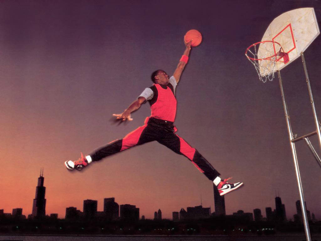 "Michael Jordan photographed in campaign for Air Jordan 1 doing what would later be known as the ""Jumpman pose"""