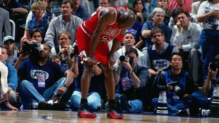Michael Jordan wearing the Air Jordan 12 Flu Game