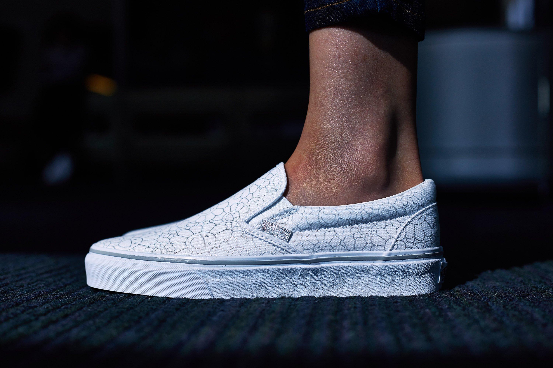 vans slip on all white on feet