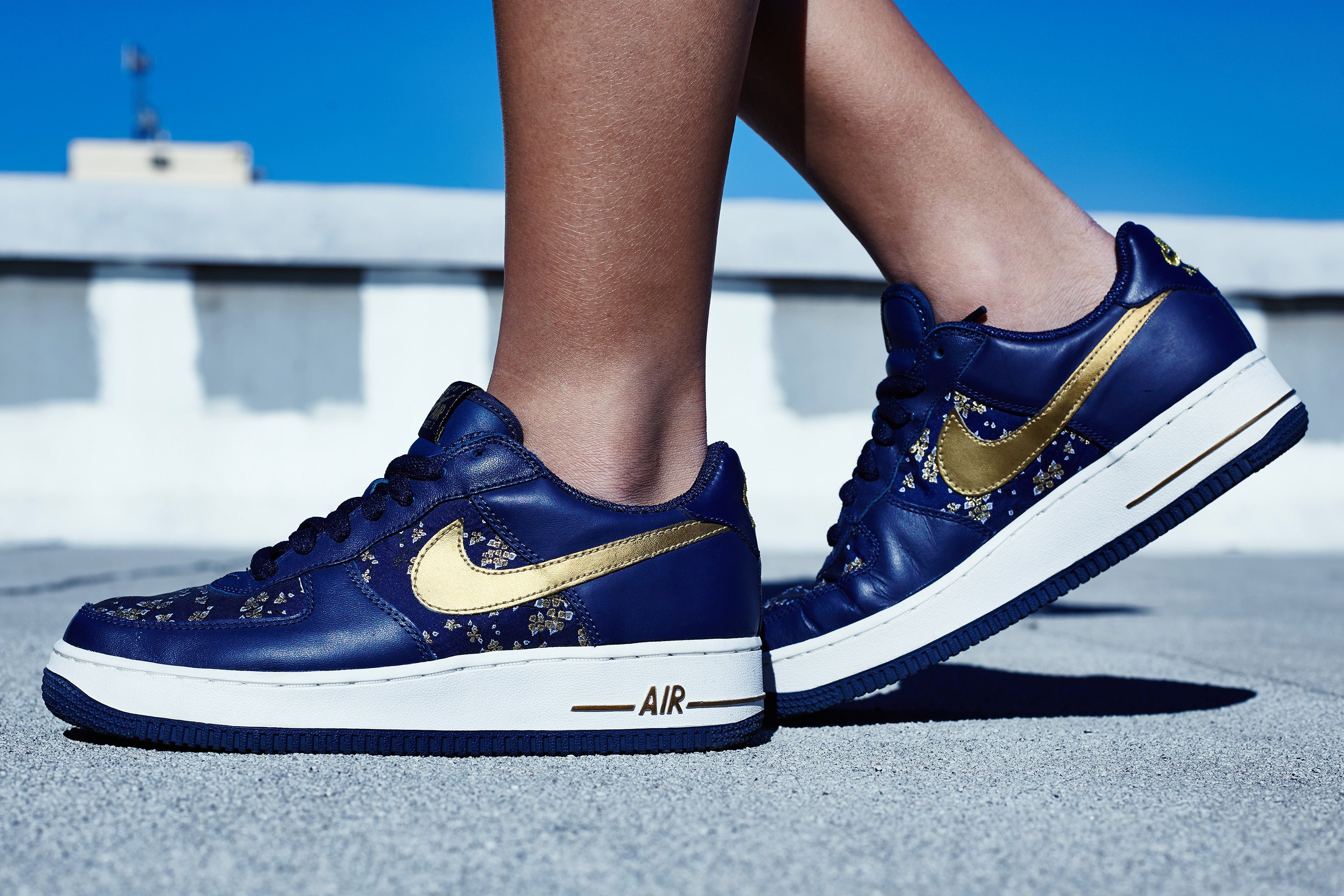 navy blue and gold air force ones