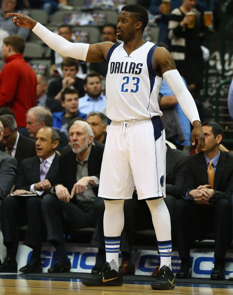 DALLAS, TX - APRIL 13:  Wesley Matthews #23 of the Dallas Mavericks during play against the San Antonio Spurs at American Airlines Center on April 13, 2016 in Dallas, Texas.  NOTE TO USER: User expressly acknowledges and agrees that, by downloading and or using this photograph, User is consenting to the terms and conditions of the Getty Images License Agreement.  (Photo by Ronald Martinez/Getty Images)