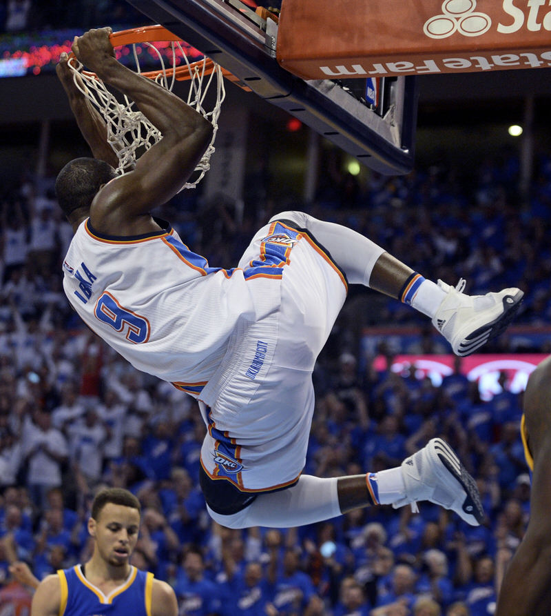 May 22, 2016; Oklahoma City, OK, USA; Oklahoma City Thunder forward Serge Ibaka (9) dunks the ball during the first quarter against the Golden State Warriors in game three of the Western conference finals of the NBA Playoffs at Chesapeake Energy Arena. Mandatory Credit: Mark D. Smith-USA TODAY Sports