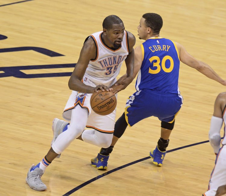 May 22, 2016; Oklahoma City, OK, USA; Oklahoma City Thunder forward Kevin Durant (35) dribbles as Golden State Warriors guard Stephen Curry (30) defends during the second quarter in game three of the Western conference finals of the NBA Playoffs at Chesapeake Energy Arena. Mandatory Credit: Mark D. Smith-USA TODAY Sports