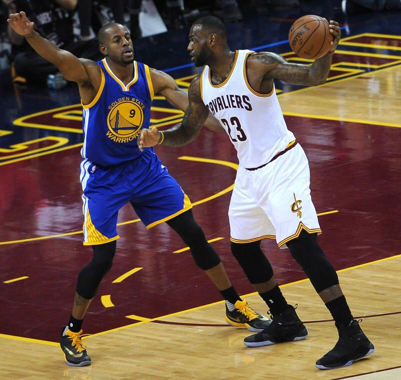 CLEVELAND, OH - JUNE 8: LeBron James #23 of the Cleveland Cavaliers handles the ball against Andre Iguodala #9 of the Golden State Warriors in Game Three of the 2016 NBA Finals on June 8, 2016 at Quicken Loans Arena in Cleveland, Ohio. NOTE TO USER: User expressly acknowledges and agrees that, by downloading and/or using this Photograph, user is consenting to the terms and conditions of the Getty Images License Agreement. Mandatory Copyright Notice: Copyright 2016 NBAE (Photo by Noah Graham/NBAE via Getty Images)
