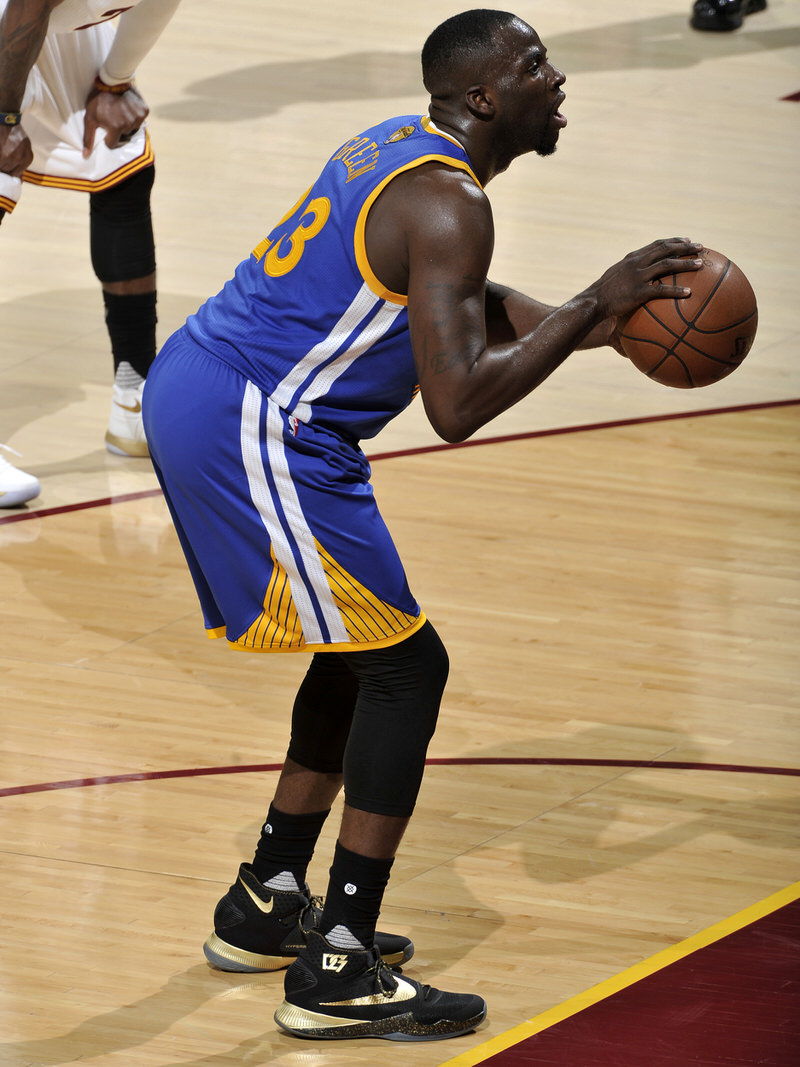 CLEVELAND, OH - JUNE 8: Draymond Green #23 of the Golden State Warriors prepares to shoot a free throw against the Cleveland Cavaliers in Game Three of the 2016 NBA Finals on June 8, 2016 at The Quicken Loans Arena in Cleveland, Ohio. NOTE TO USER: User expressly acknowledges and agrees that, by downloading and or using this photograph, user is consenting to the terms and conditions of Getty Images License Agreement. Mandatory Copyright Notice: Copyright 2016 NBAE (Photo by David Liam Kyle/NBAE via Getty Images)