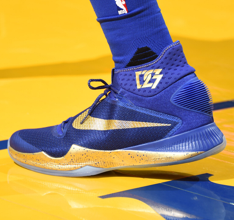 OAKLAND, CA - JUNE 5: The sneakers of Draymond Green #23 of the Golden State Warriors during the game against the Cleveland Cavaliers in Game Two of the 2016 NBA Finals on June 5, 2016 at ORACLE Arena in Oakland, California. NOTE TO USER: User expressly acknowledges and agrees that, by downloading and/or using this Photograph, user is consenting to the terms and conditions of the Getty Images License Agreement. Mandatory Copyright Notice: Copyright 2016 NBAE (Photo by Andrew D. Bernstein/NBAE via Getty Images)