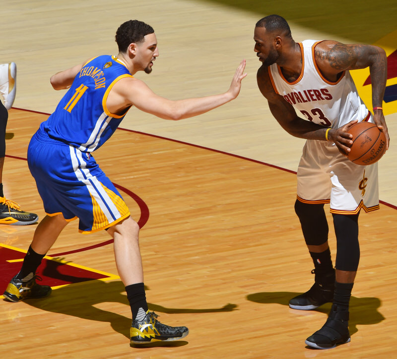 CLEVELAND, OH - JUNE 8: LeBron James #23 of the Cleveland Cavaliers handles the ball against Klay Thompson #11 of the Golden State Warriors in Game Three of the 2016 NBA Finals on June 8, 2016 at Quicken Loans Arena in Cleveland, Ohio. NOTE TO USER: User expressly acknowledges and agrees that, by downloading and/or using this Photograph, user is consenting to the terms and conditions of the Getty Images License Agreement. Mandatory Copyright Notice: Copyright 2016 NBAE (Photo by Jesse D. Garrabrant/NBAE via Getty Images)