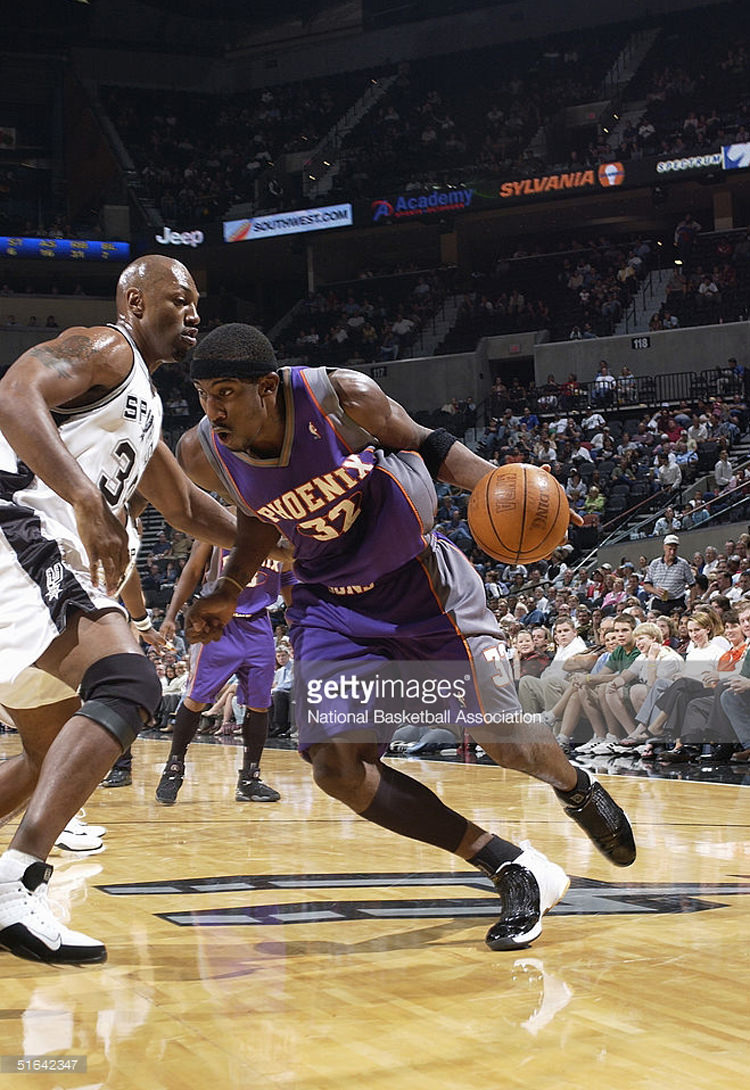 SAN ANTONIO - OCTOBER 19: Amare Stoudemire #32 of the Phoenix Suns drives against Tony Massenburg #34 of the San Antonio Spurs during a preseason game on October 19, 2004 at SBC Center in San Antonio, Texas. The Suns won 104-96. NOTE TO USER: User expressly acknowledges and agrees that, by downloading and/or using this Photograph, user is consenting to the terms and conditions of the Getty Images License Agreement. Mandatory Copyright Notice: Copyright 2004 NBAE (Photo by D.Clarke Evans/NBAE via Getty Images.) *** Local Caption *** Amare Stoudemire;Tony Massenburg