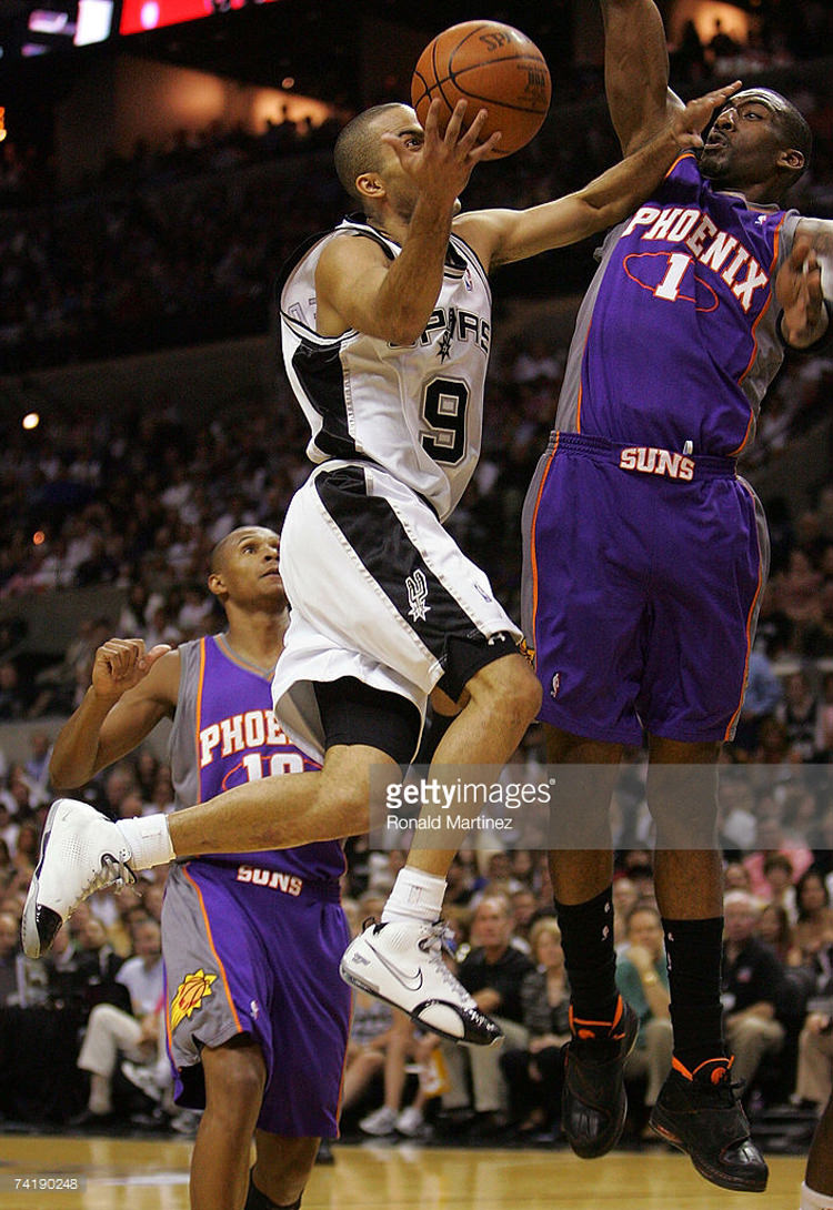 SAN ANTONIO - MAY 18: Guard Tony Parker #9 of the San Antonio Spurs takes a shot against Amare Stoudemire #1 of the Phoenix Suns in Game Six of the Western Conference Semifinals during the 2007 NBA Playoffs at AT&T Center on May 18, 2007 in San Antonio, Texas. NOTE TO USER: User expressly acknowledges and agrees that, by downloading and or using this photograph, User is consenting to the terms and conditions of the Getty Images License Agreement. (Photo by Ronald Martinez/Getty Images) *** Local Caption *** Tony Parker;Amare Stoudemire