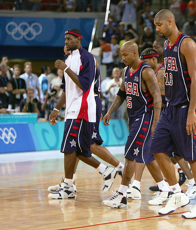ATHENS - AUGUST 21: Lead by Tim Duncan #13, the United States walks off the court after a loss to Lithuania in a men's basketball preliminary game on August 21, 2004 during the Athens 2004 Summer Olympic Games at the Indoor Arena of the Helliniko Olympic Complex in Athens, Greece. (Photo by Scott Barbour/Getty Images) *** Local Caption *** Tim Duncan;LeBron James;Stephon Marbury