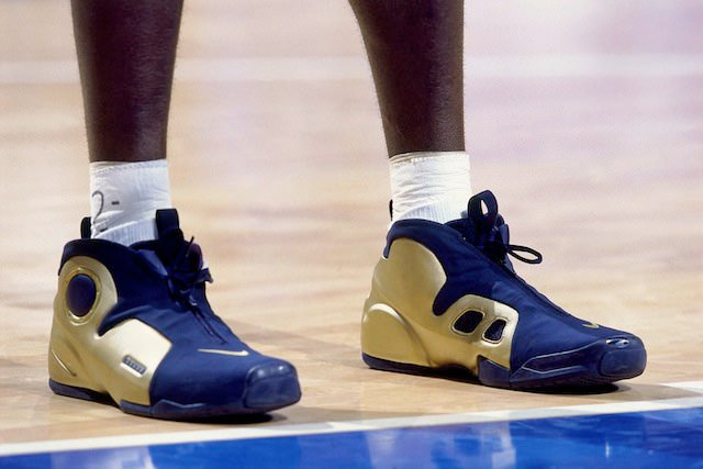 SYDNEY - SEPTEMBER 30: Kevin Garnett of the United States National Team shows off his sneakers against the French National team during the 2000 Summer Olympics played September 30, 2000 in Sydney, Australia. NOTE TO USER: User expressly acknowledges that, by downloading and or using this photograph, User is consenting to the terms and conditions of the Getty Images License agreement. Mandatory Copyright Notice: Copyright 2000 NBAE (Photo by Nathaniel S. Butler/NBAE via Getty Images)