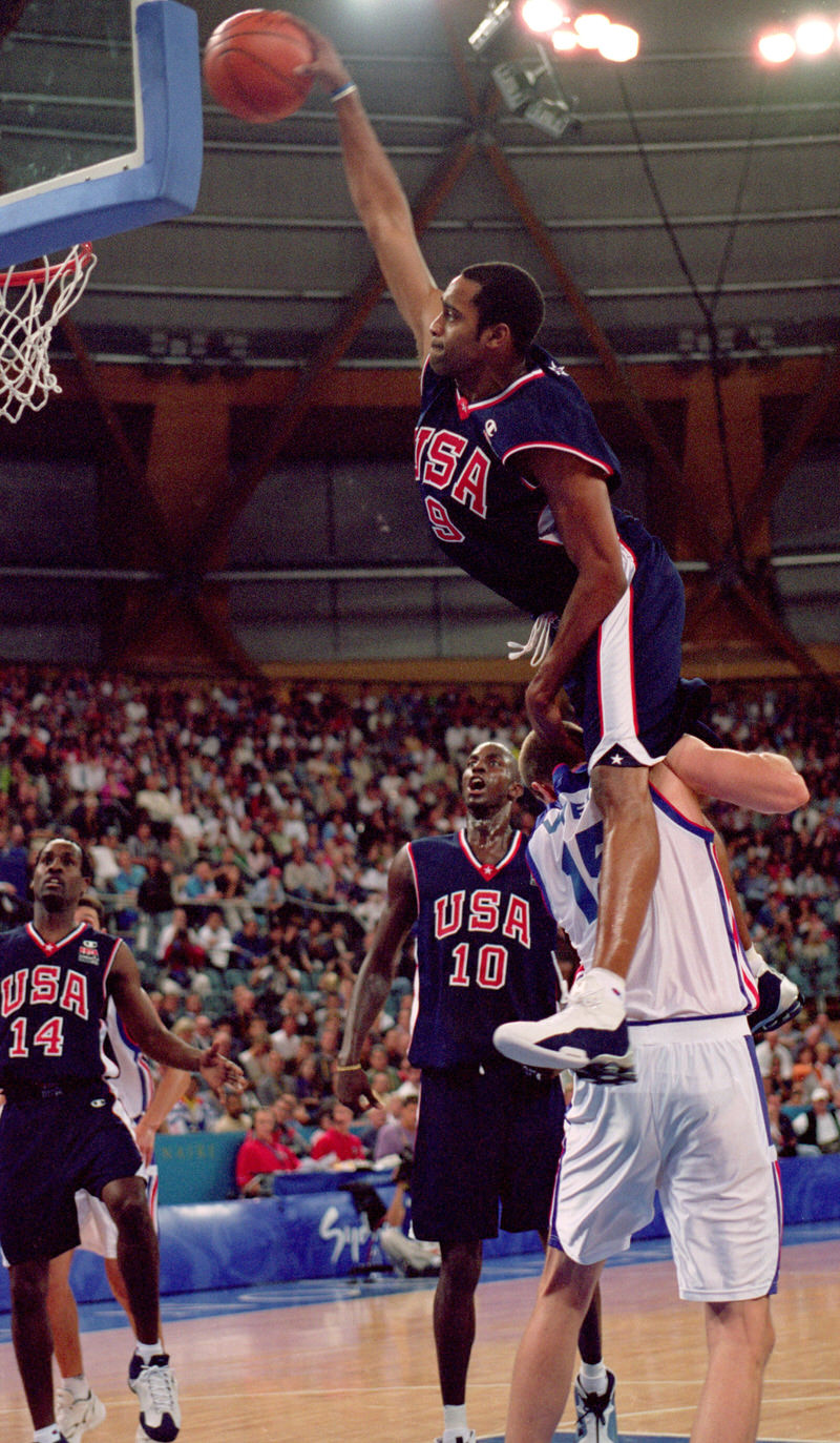 25 Sep 2000: Vince Carter of the USA leaps over Frederic Weis of France to dunk during the Mens Basketball Preliminaries at the Dome in the Olympic Park on Day 10 of the Sydney 2000 Olympic Games in Sydney, Australia. Mandatory Credit: Darren McNamara/Allsport