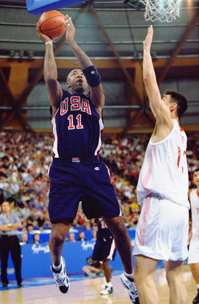 17 Sep 2000: Vin Baker of the USA up against Ming Yao of China during the Men's Basketball Preliminaries at the Sydney Superdome on Day Two of the Sydney 2000 Olympic Games in Sydney, Australia. Mandatory Credit: Jed Jacobsohn /Allsport