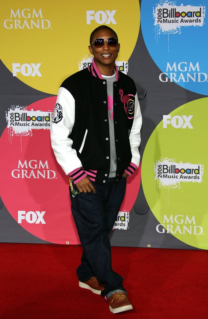 Pharrell in brown leather A Bathing Ape Bapestas (photo by Ethan Miller/Getty Images via