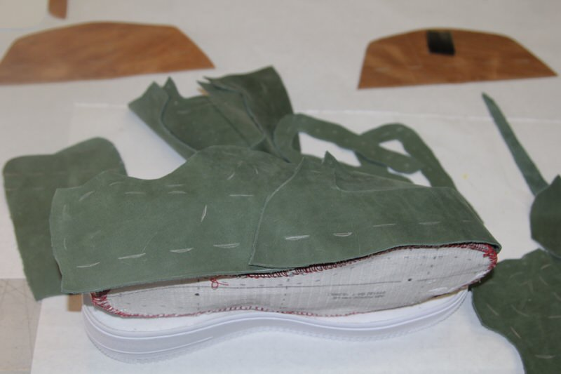 Laying out the leather pieces of an Air Force 1