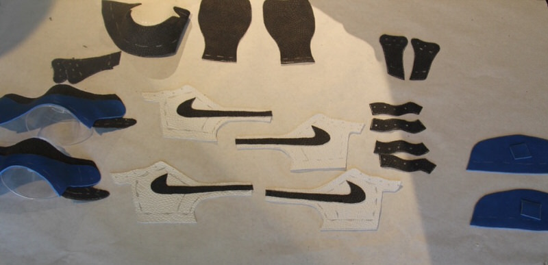 Laying out the pattern of the Air Jordan 1 and allowing the adhesive to dry