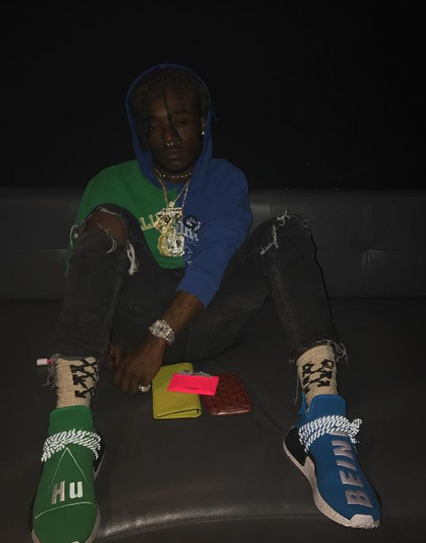Lil Uzi Vert in mismatching Pharrell x adidas NMDs