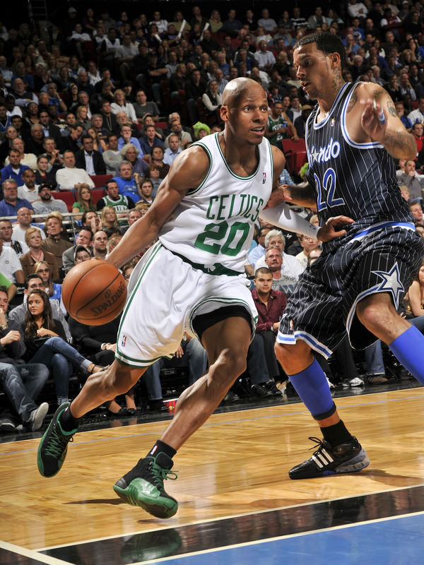 ORLANDO, FL - JANUARY 28: Ray Allen #20 of the Boston Celtics moves the ball against Matt Barnes #22 of the Orlando Magic during the game on January 28, 2010 at Amway Arena in Orlando, Florida. NOTE TO USER: User expressly acknowledges and agrees that, by downloading and or using this photograph, User is consenting to the terms and conditions of the Getty Images License Agreement. Mandatory Copyright Notice: Copyright 2010 NBAE (Photo by Fernando Medina/NBAE via Getty Images)