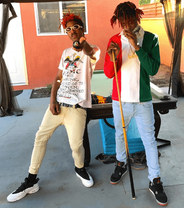 Lil Tracy in the Nike Air Flare & Famous Dex in the Air Jordan 4 Black/Red