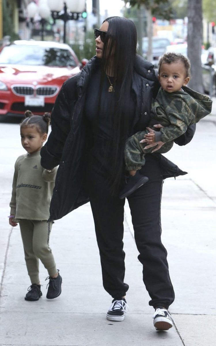 Kim Kardashian in the Vans Old Skool with Saint & North both in the adidas Yeezy Boost 350
