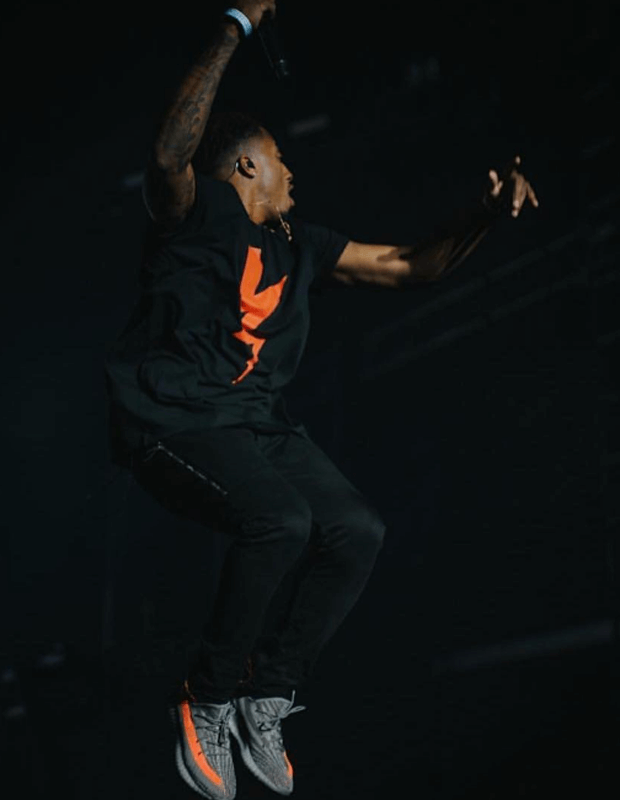 Lecrae in the adidas Yeezy Boost 350 V2 Beluga/Solar Red