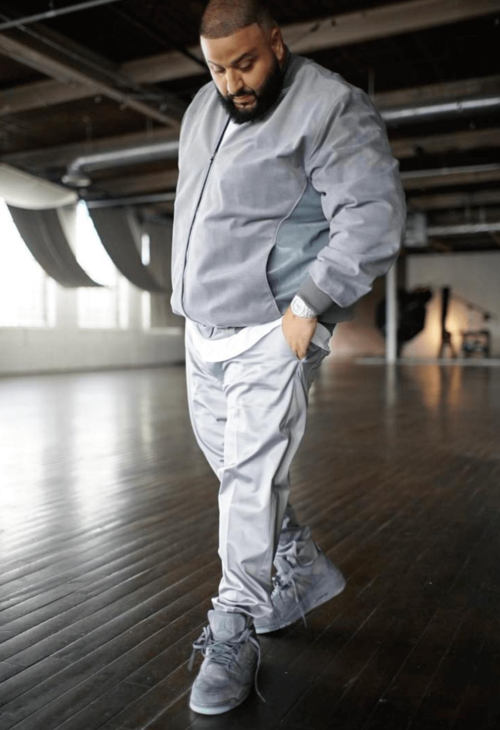 DJ Khaled in Kaws x Air Jordan 4 Retro