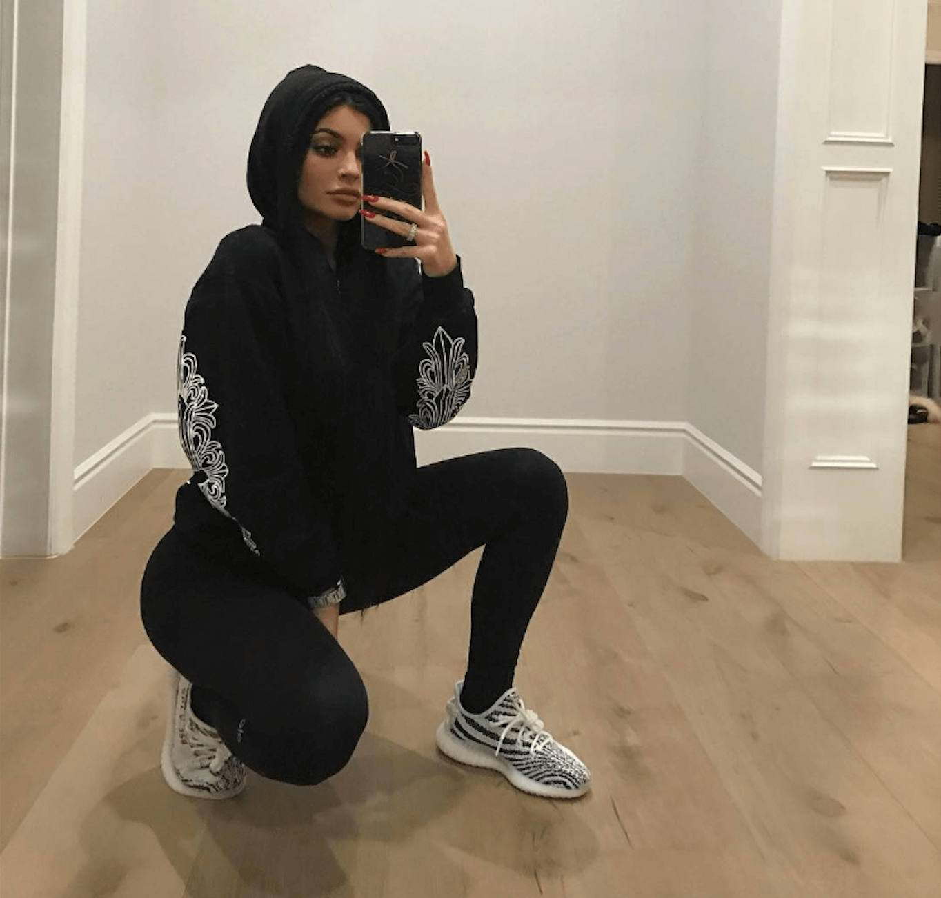 "Kylie Jenner in the adidas Yeezy Boost 350 V2 ""Zebra"""