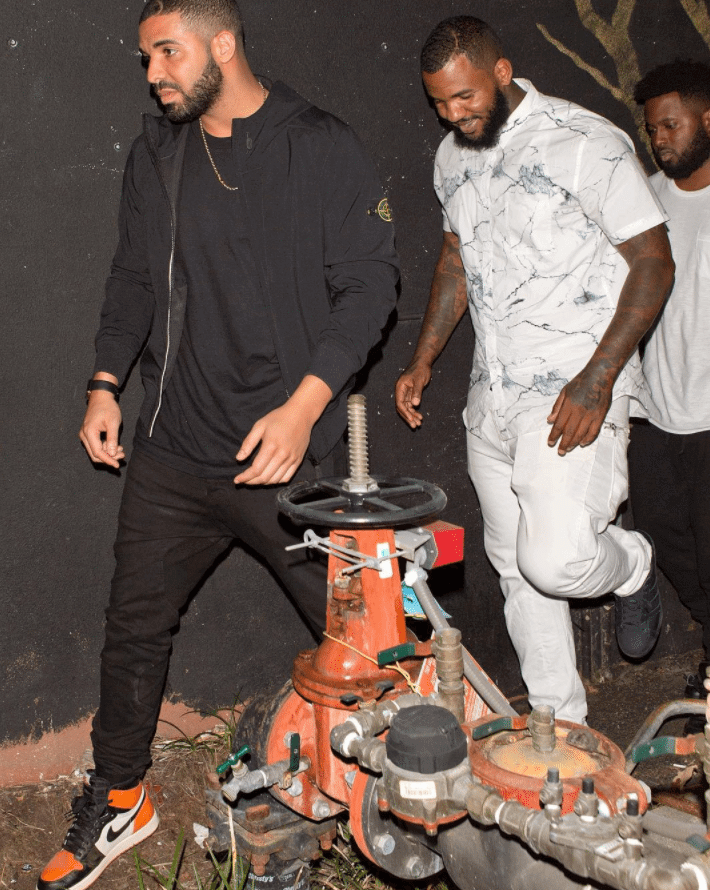 "Drake in the Air Jordan 1 Retro High OG ""SBB"" & The Game in the Adidas Superstar"