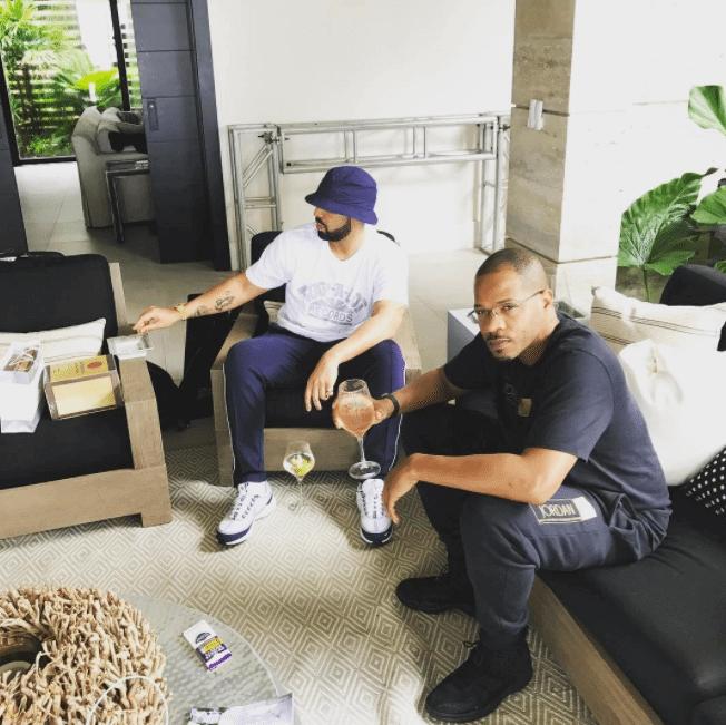 "Drake in the Nike Air Zoom Spiridon & OVO Noel in the Air Jordan 12 Retro ""OVO"""