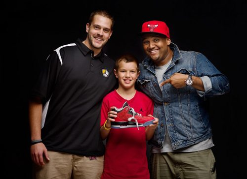 Cole Johanson, age 11, with his Nike design team, Jake Van Damm, left, Jason Mayden, right, and Cole's Air Jordan III for the Doernbecher Freestyle Collection.