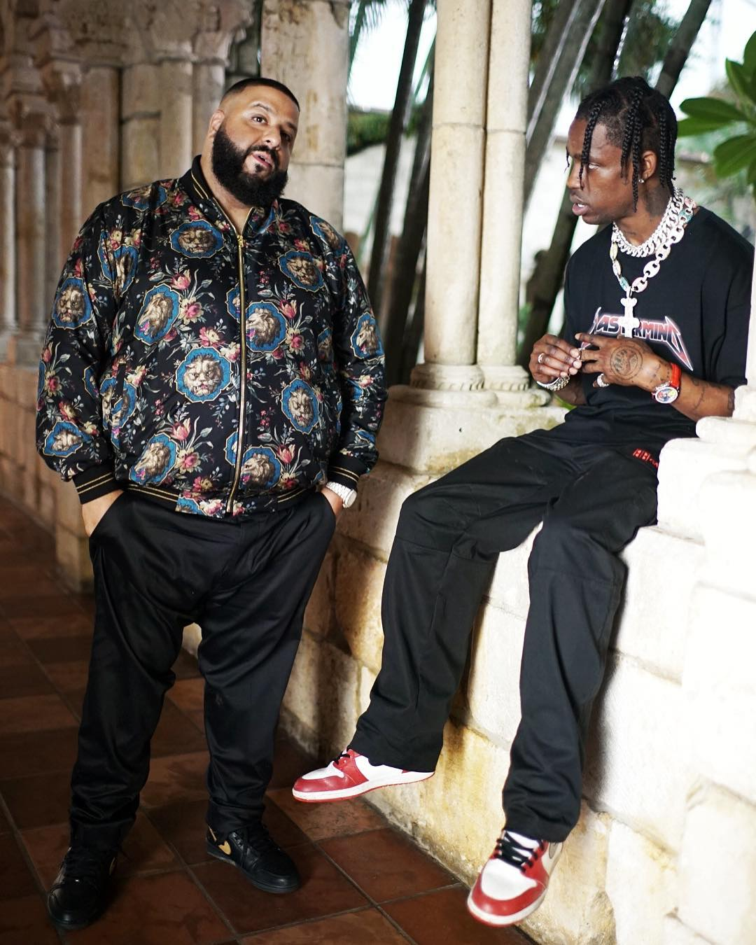 "DJ Khaled in the Air Jordan 1 Black/Gold & Travis Scott in the Air Jordan 1 ""Chicago"""