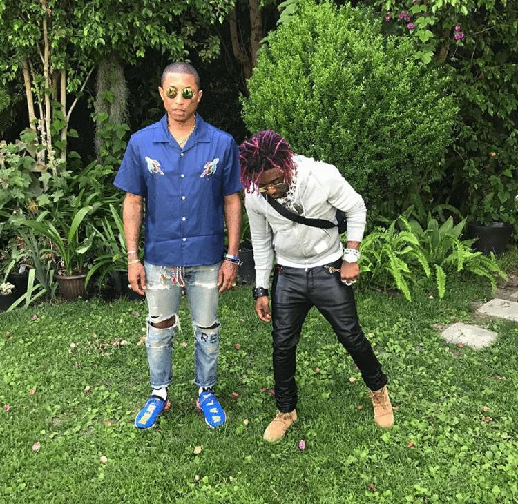 Pharrell in new Pharrell x adidas NMDs