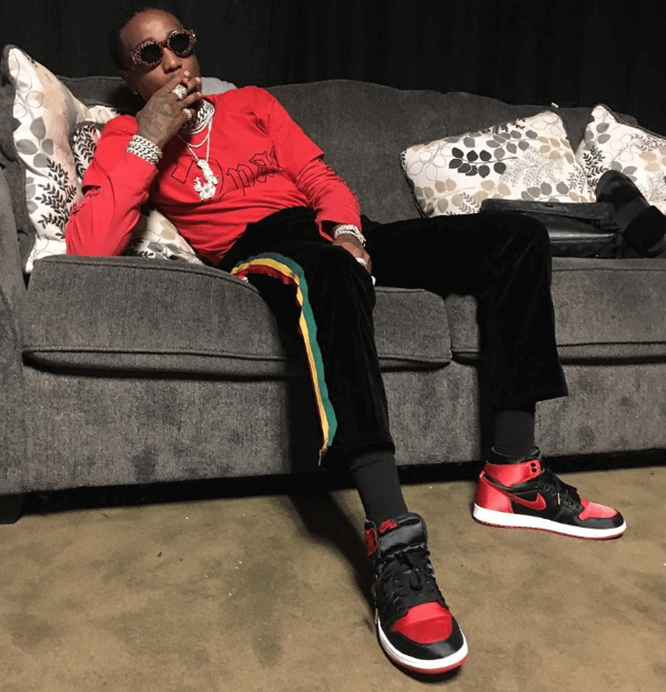 "Quavo in the Air Jordan 1 Satin ""Banned"""