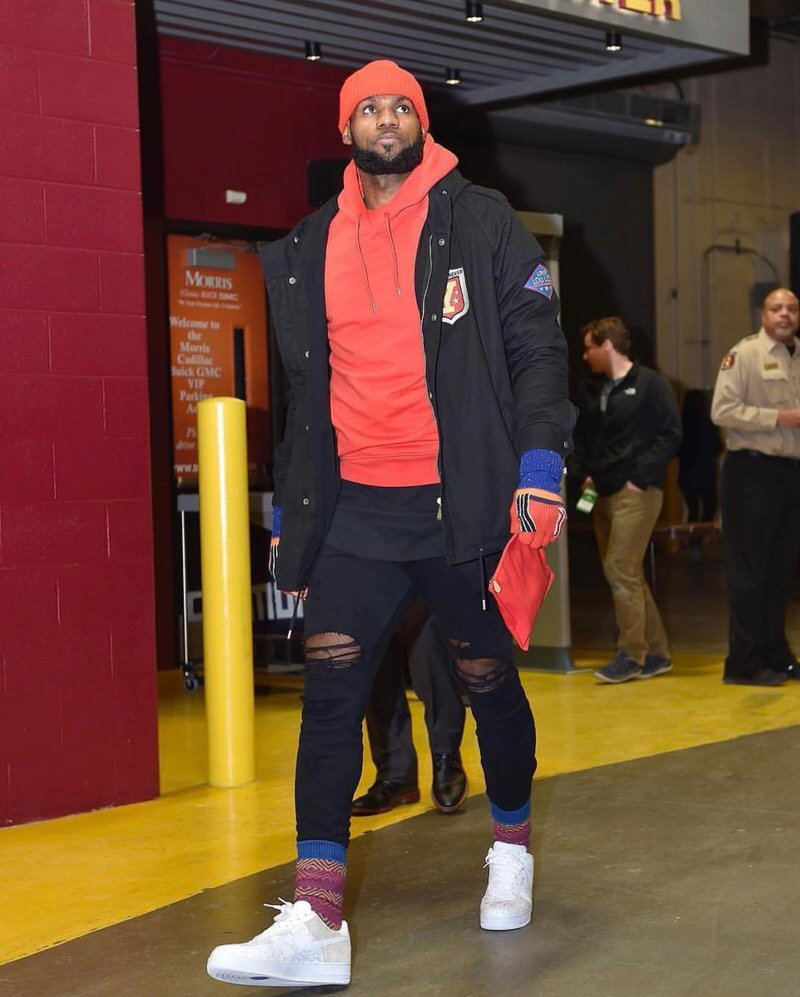 LBJ's winter status is locked in, finding subtle ways to pepper in vibrant color pops to his traditionally all black wardrobe.