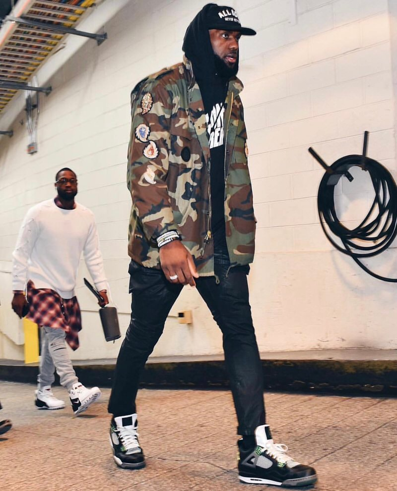 LBJ shows off his inner style nerd with a Billionaire Boys Club sweatshirt, Rick Owens jeans, and a pair of Oregon Jordan 4 PEs.