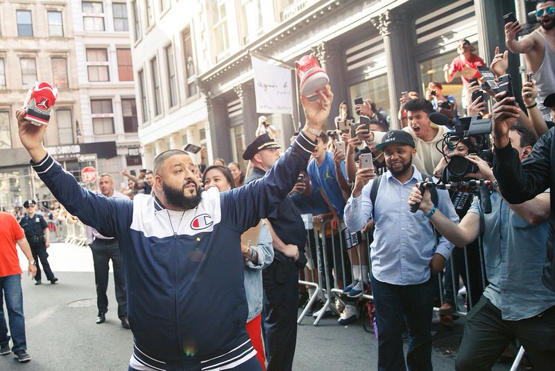DJ Khaled holds his Air Jordan 3 collaboration at event outside of Stadium Goods