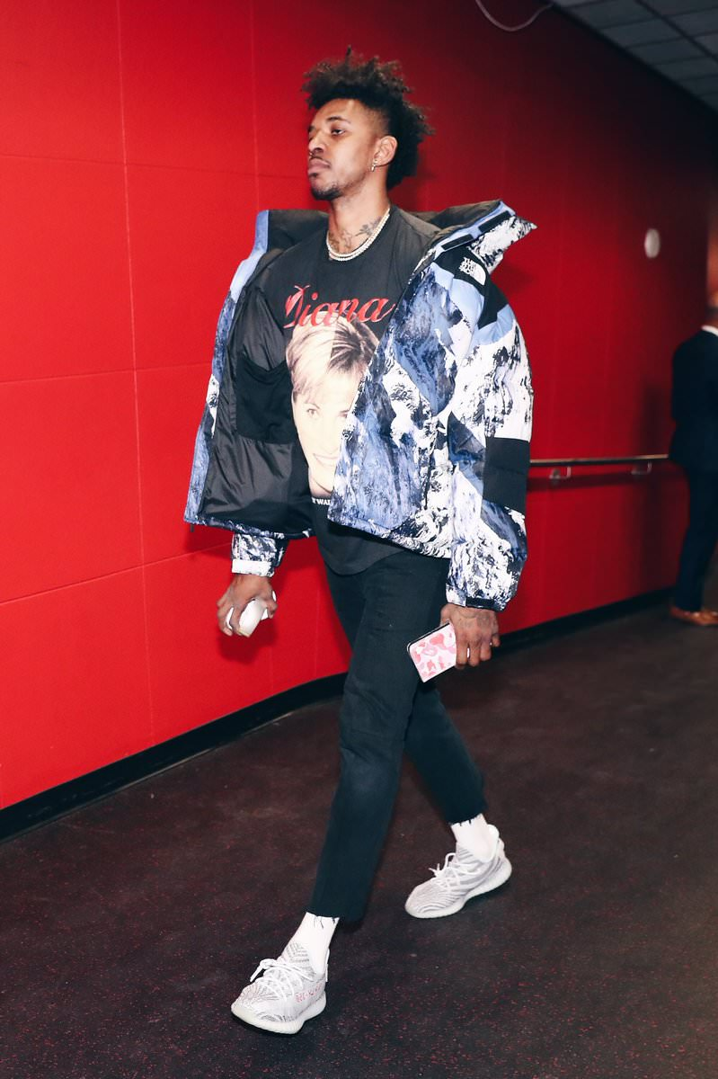 Swaggy P's look here is pretty icy.