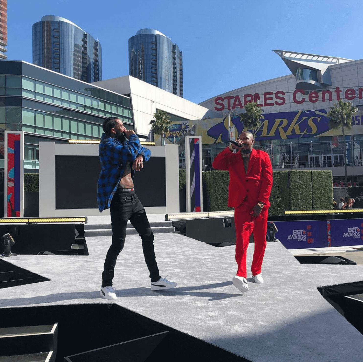 Nipsey Hustle in the Puma Clyde & YG in the Nike Cortez