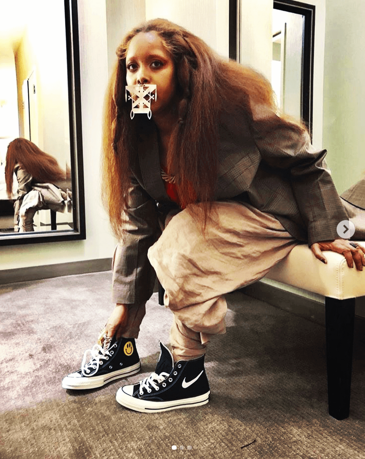 Erykah Badu in the China Town Market Converse Chuck Taylor