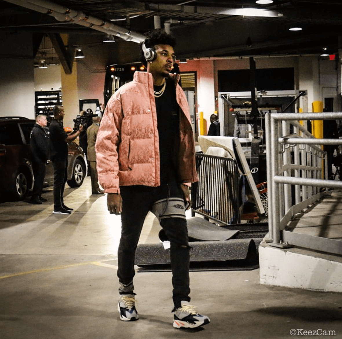 Swaggy P's pink jacket and Yeezy's add some contrast to his otherwise muted styling.