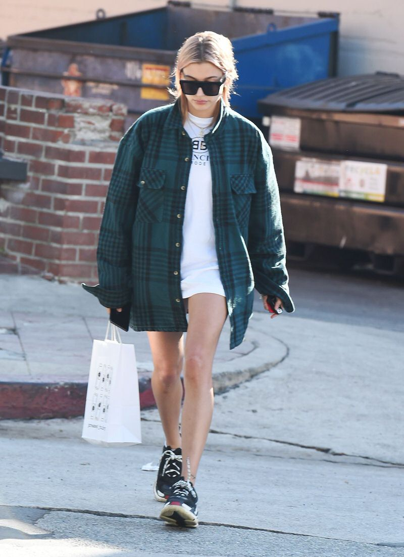 Hailey Baldwin pairs an oversized flannel with the Balenciaga Triple-S.