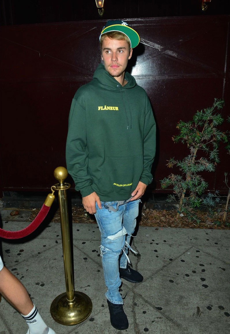 Oakland A's inspired. JB wears Fear of God cap, jeans, and Flaneur hoodie.