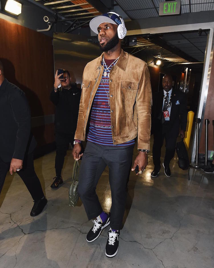 LeBron James goes in on the tailored men's suiting trend with the Supreme x COMME des GARCONS x Nike Air Force 1 Low.