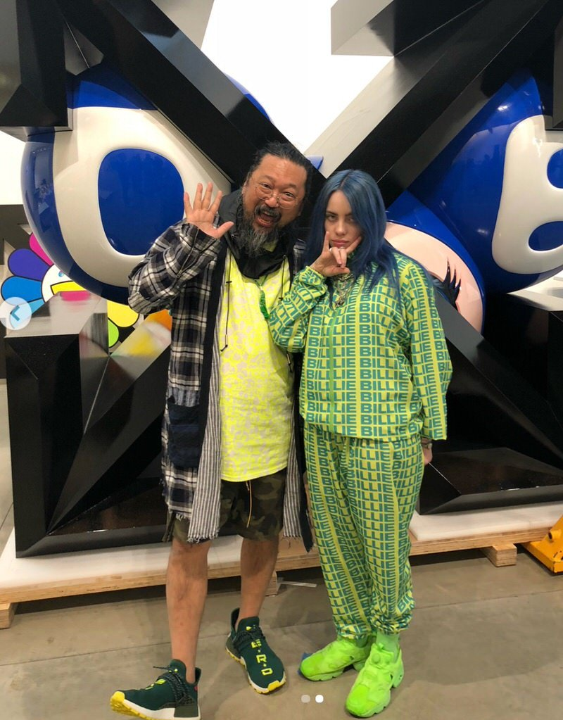 "Takashi Murakami in the adiadss x Pharrell Williams NMD Hu ""N.E.R.D."" & Billie Eilish in the Reebok Instapump Fury"