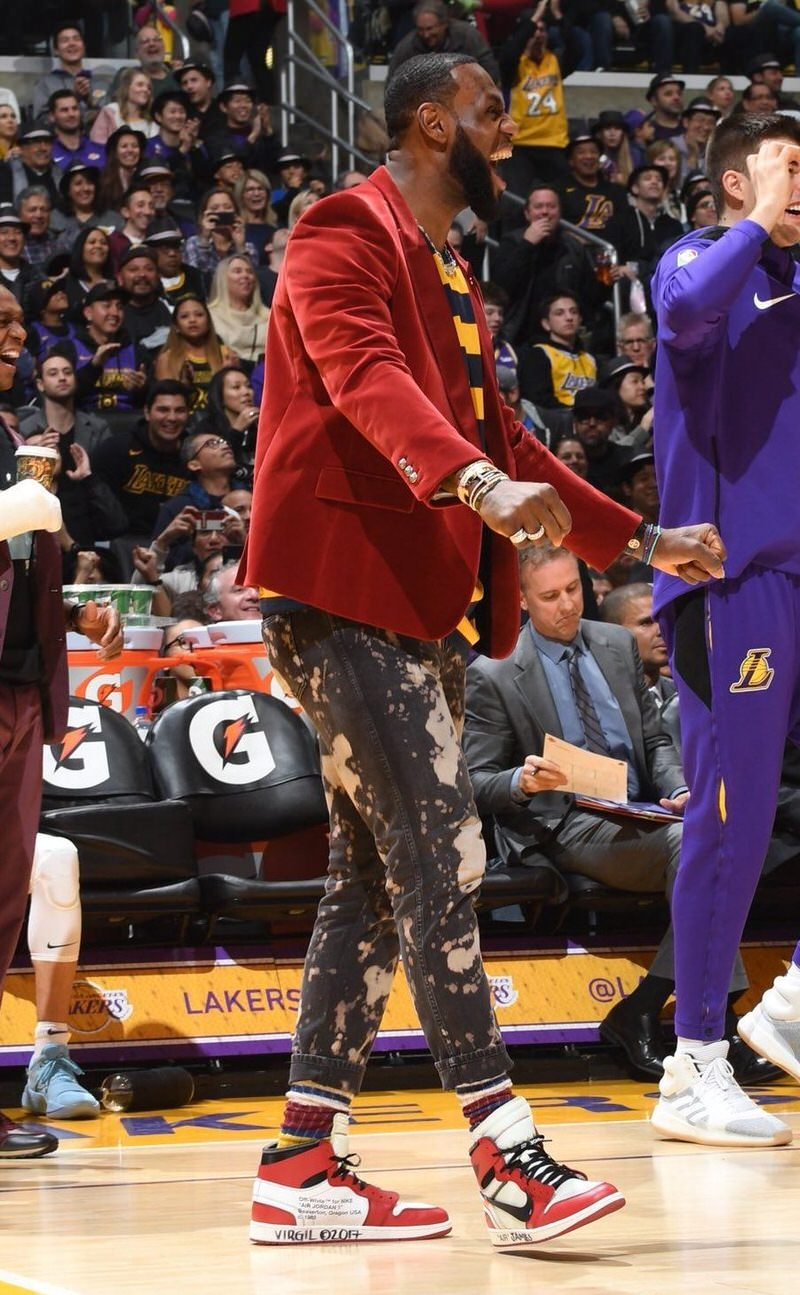 """LeBron adopts LA's punk rock personality with acid wash Gucci jeans, contrasting striped shirts, vibrant socks, and OFF-WHITE x Jordan 1 """"Chicagos."""""""