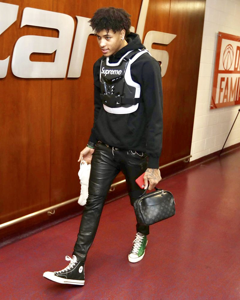 Kelly Oubre takes extra precaution before showing up to the game.