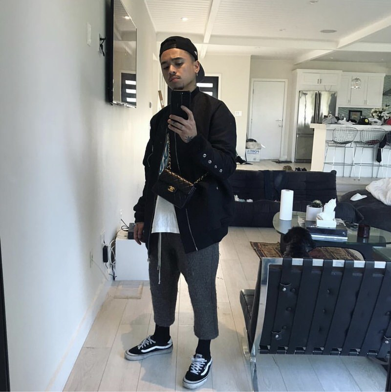 Fashion isn't just about the clothes anymore. It's the accessories as well. Rhuigi uses one of the Chanel offerings as his cross-body bag of choice.