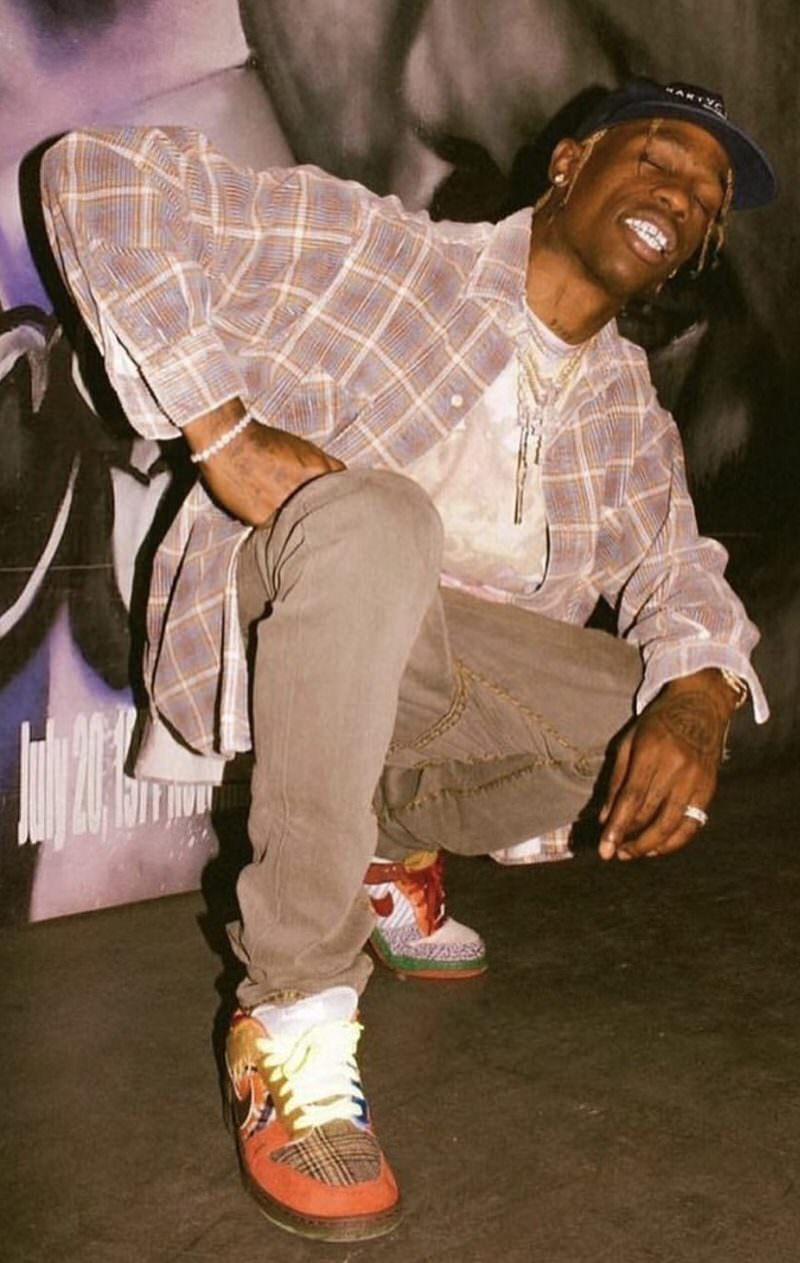 Travis Scott wearing the majority of his most grailed Dunks in one pair.