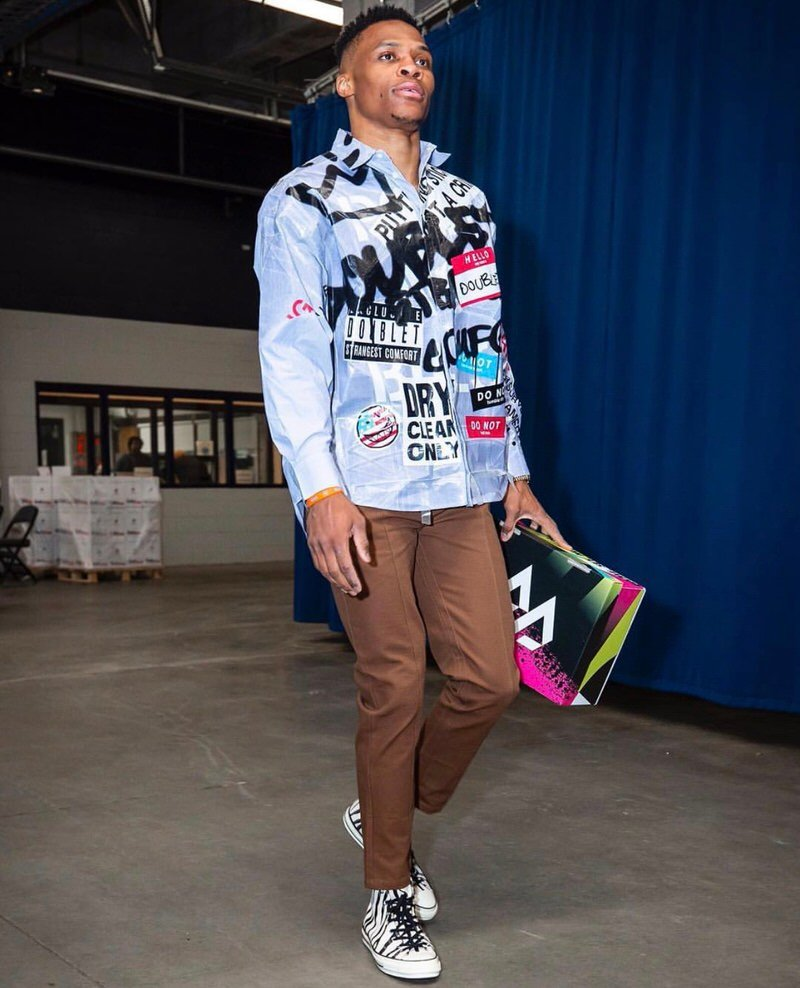 Russell Westbrook unites cropped trousers with Converse CT 70s.